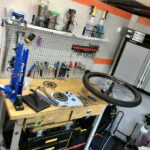 Workbench with bike wheel and parts